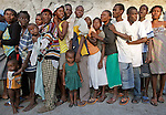 Earthquake aftermath in Cité Soleil, Haiti on Sunday, January 24, 2010. Haitian children and adults lineup for food and water as a Brazilian battalion and the U.S. Army join forces to distribute aid.