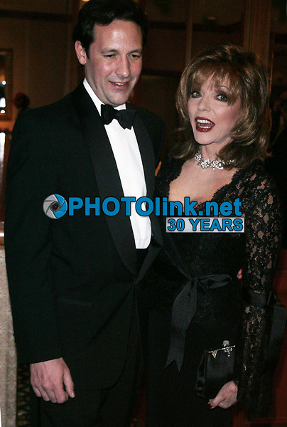 CelebrityArchaeology.com<br /> New York City<br /> 2002 FILE PHOTO<br /> JOAN COLLINS AND HUSBAND<br /> Photo By John Barrett-PHOTOlink.net<br /> -----<br /> CelebrityArchaeology.com, a division of PHOTOlink,<br /> preserving the art and cultural heritage of celebrity<br /> photography from decades past for the historical<br /> benefit of future generations, for these images are<br /> significant, both historically and aesthetically.<br /> ——<br /> Follow us:<br /> www.linkedin.com/in/adamscull<br /> Instagram: CelebrityArchaeology<br /> Blog: CelebrityArchaeology.info<br /> Twitter: celebarcheology