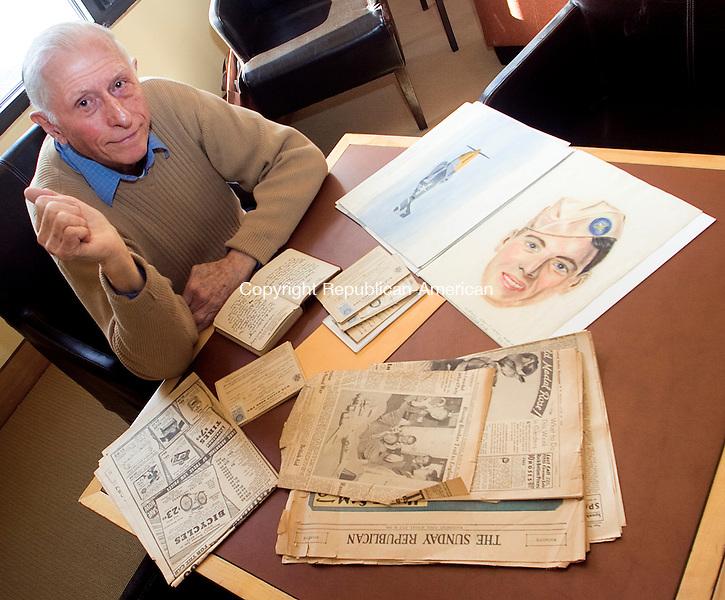 LITCHFEILD CT.-09 NOVEMBER 2010 110910DA04-  Lloyd Wellnitz of Litchfield sits at a table full of memorabilia as he remembers back to World War II.<br /> Darlene Douty Republican-American