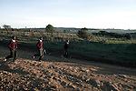 ELDORET, KENYA - MAY 19: Jonathan Kitum, age 16, and Eliud Kibet, age 18, and a friend are jogging to Kipkeino Highschool early in the morning as the sun goes up. They are promising long distance runners and they have already trained for an hour from 5.15 in the morning. (Photo by: Per-Anders Pettersson)