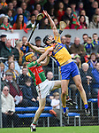 Donnchada Murphy of  Clooney-Quin in action against Cathal Malone of  Sixmilebridge during their senior county final at Cusack Park. Photograph by John Kelly.