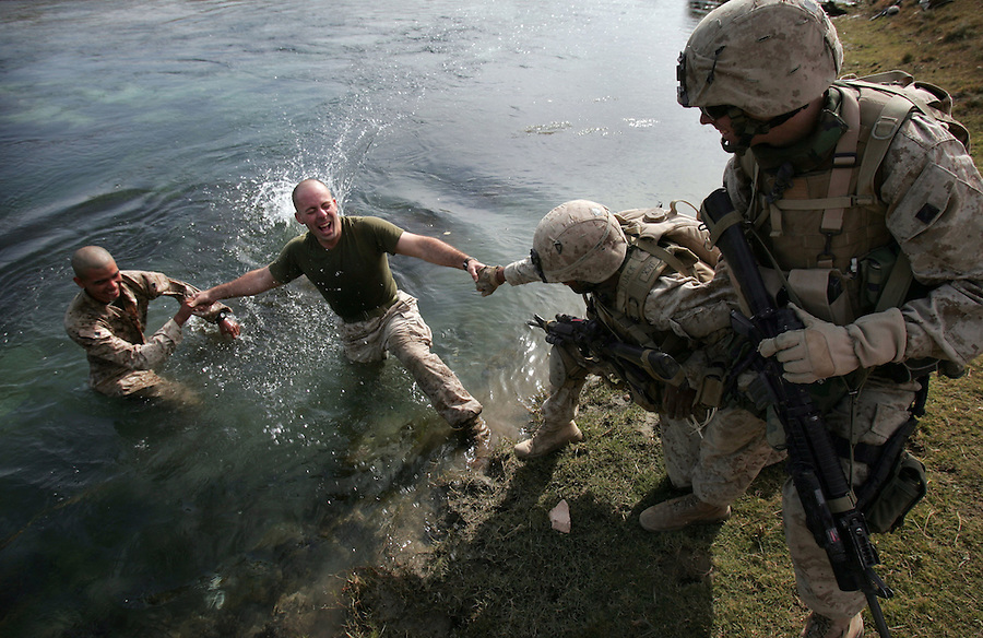 Marines with 2nd Platoon 3rd BN 1st Marines enjoy a bit of frivolity as they search for weapons hidden by insurgents in the waters and along the banks of the Euphrates River in Haditha, Iraq on Tues. Nov. 21, 2005.