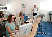 Journalists learning extra skills (setting up a website) at the National Union of Journalists training centre, London,  with instructor, Chris Wheal.