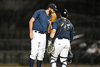 Pitcher Ryan Selmer (27) of the Columbia Fireflies talks with catcher Scott Manea (25) in a game against the Charleston RiverDogs on Monday, August 27, 2018, at Spirit Communications Park in Columbia, South Carolina. Charleston won, 4-0. (Tom Priddy/Four Seam Images)