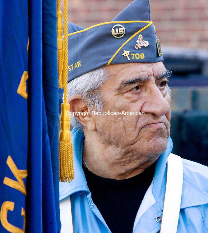 NAUGATUCK, CT. 11 November 2010-111110SV13--Manny Matos of the Catholic War Vets carries the American Legion flag during the Veterans Day parade in Naugatuck Thursday.<br /> Steven Valenti Republican-American