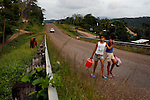 BELIZE - SEPTEMBER 12, 2007:  Two girls walk along the Hummingbird Highway north of Ian Anderson's Cave Branch on September 12, 2007 in Belize.  (PHOTOGRAPH BY MICHAEL NAGLE)