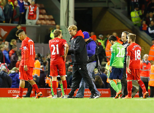 25.10.2015. Anfield, Liverpool, England. Barclays Premier League. Liverpool versus Southampton. Liverpool manager Jurgen Klopp comes onto the pitch at the end of the game and speaks to Liverpool midfielder Lucas Leiva.