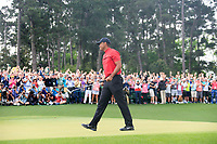 Tiger Woods (USA) sinks his putt to win The 2019 Masters , Augusta National, Augusta, Georgia, USA. 14/04/2019.<br /> Picture Fran Caffrey / Golffile.ie<br /> <br /> All photo usage must carry mandatory copyright credit (© Golffile | Fran Caffrey)