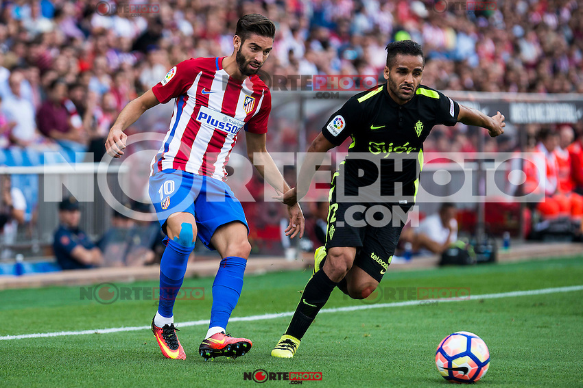 Atletico de Madrid's player Yannick Carrasco and Sporting de Gijon's Douglas during a match of La Liga Santander at Vicente Calderon Stadium in Madrid. September 17, Spain. 2016. (ALTERPHOTOS/BorjaB.Hojas) /NORTEPHOTO