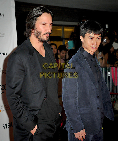 Keanu Reeves, Tiger Hu Chen<br /> &quot;Man Of Tai Chi&quot; Premiere - 2013 Toronto International Film Festival held at Ryerson Theatre, Toronto, Ontario, Canada.<br /> September 10th, 2013<br /> half length black suit jacket top beard facial hair blue<br /> CAP/ADM/BPC<br /> &copy;Brent Perniac/AdMedia/Capital Pictures