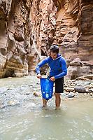 Water filtering deep inside a desert canyon.