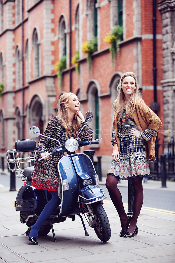 NO REPRO FEE. 31/8/2011. A|wear's new autumn '11 collection. Sarah Morrissey & Thalia Heffernan model a selection of dresses at the Powerscourt Town House Dublin. Sarah wears a Navy print dress - EUR50,Mustard cardigan - EUR40.  Thalia wears a Red and black pleated dress - EUR40, Black belt - EUR10. The full range is available in all A|wear stores and online at www.awear.com now. Picture James Horan/Collins Photos