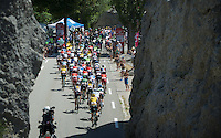 peloton riding through the Claps (rock formations) de Luc en Diois<br /> <br /> stage 16: Bourg de Péage - Gap (201km)<br /> 2015 Tour de France