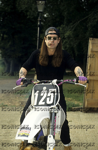 Ozzy Osbourne - photographed on a mountain bike exclusively at home in Buckinghamshire UK  - 09 Sep 1996.  Photo credit: George Chin/IconicPix