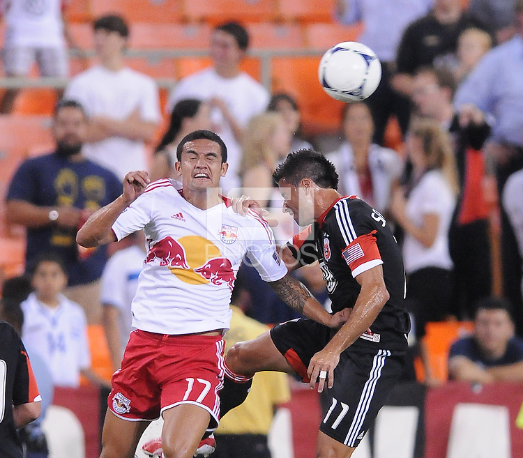 D.C. United midfielder Marcelo Saragosa (11) heads the ball against New York Red Bulls forward Tim Cahill (17) The New York Red Bulls tied D.C. United 2-2 at RFK Stadium, Wednesday August 29, 2012.