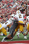 Jeremiah Allison (8) and Darryl Paulo (99), Washington State University linebacker and defensive lineman, pressure the quarterback during the Cougars non-conference game against the Wyoming Cowboys at Martin Stadium in Pullman, Washington, on September 19, 2015.  The Cougs used a dominating final three quarters to put away the Cowboys, 31-14.