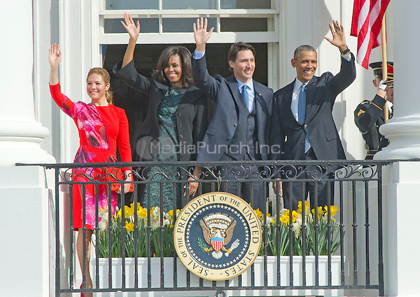 United States President Barack Obama, right, First Lady Michelle Obama, left center, and Prime Minister Justin Trudeau of Canada, right center, and and Mrs. Sophie Gr&Egrave;goire Trudeau, left, wave from the South Portico of the White House following an Arrival Ceremony in Washington, DC on Thursday, March 10, 2016. <br /> Credit: Ron Sachs / CNP/MediaPunch