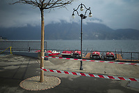 "Switzerland. Canton Ticino. Lugano. A police line forbids the access to the lake because of coronavirus (also called Covid-19). Due to the spread of the coronavirus , the Federal Council has categorised the situation in the country as ""extraordinary"". It has issued a recommendation to all citizens to stay at home, especially the sick and the elderly. The Federal Council (German: Bundesrat, French: Conseil fédéral, Italian: Consiglio federale, Romansh: Cussegl federal) is the seven-member executive council that constitutes the federal government of the Swiss Confederation. From March 16 the government ramped up its response to the widening pandemic, ordering the closure of bars, restaurants, sports facilities and cultural spaces. Only businesses providing essential goods to the population – such as grocery stores, bakeries and pharmacies – are to remain open. Lake Lugano (also called Ceresio) is a glacial lake which is situated on the border between southern Switzerland and Northern Italy. 22.03.2020 © 2020 Didier Ruef"