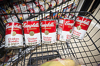 Cans of Campbell's iconic Chicken Noodle Soup are seen in a supermarket in New York on Tuesday, November 10, 2015. The Campbell Soup Co. announced that it will alter the recipe of its soup products including the classic Chicken Noodle Soup removing ingredients that have fallen out of favor with consumers, such as MSG and vegetable oils. The new products will be released with Star Wars licensed labeling.  (© Richard B. Levine)