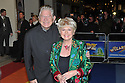 """© Under licence London News Pictures. 01/03/2011. Celebrities arrive for the Opening Night of """"The Wizard of Oz"""" at the London Palladium. Gloria Hunniford and husband. Picture credit should read: Jane Hobson/London News Pictures"""