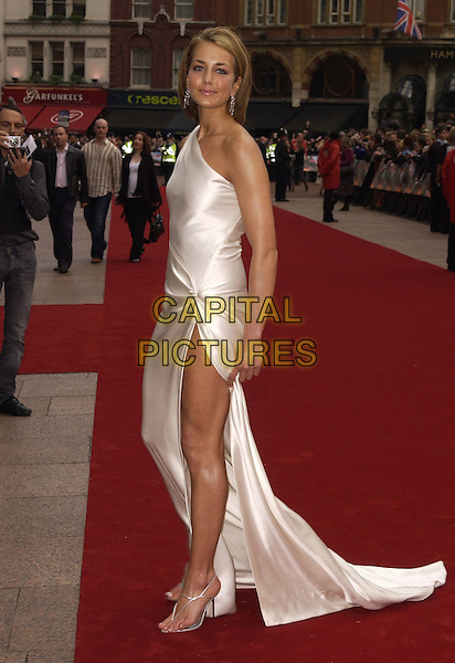 "LADY ISABELLA HERVEY.""Mission Impossible 3"" UK Film Premiere - Arrivals, Odeon Leicester Square, London, UK. .April 25th 2006.Ref: CAN.full length white silk satin dress long thigh leg side split slit one shoulder.www.capitalpictures.com.sales@capitalpictures.com.©Capital Pictures"
