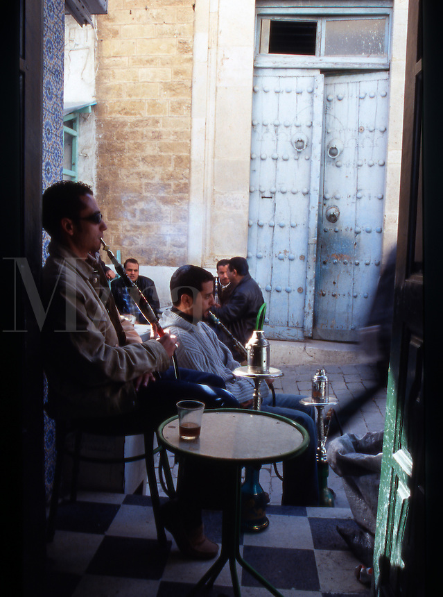 North Africa. Tunisia. Men sat smoking Hookah's in The Medina in Tunis..