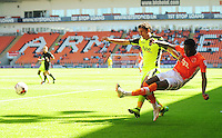 Blackpool's Bright Osayi-Samuel crosses the ball despite the attentions of Exeter City's Craig Woodman<br /> <br /> Photographer Kevin Barnes/CameraSport<br /> <br /> Football - The EFL Sky Bet League Two - Blackpool v Exeter City - Saturday 6th August 2016 - Bloomfield Road - Blackpool<br /> <br /> World Copyright &copy; 2016 CameraSport. All rights reserved. 43 Linden Ave. Countesthorpe. Leicester. England. LE8 5PG - Tel: +44 (0) 116 277 4147 - admin@camerasport.com - www.camerasport.com