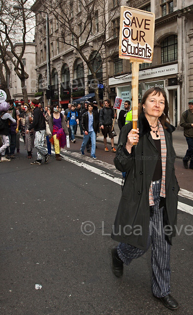 """London, 26/03/2011. """"The 2011 anti-cuts protest in London"""" organised by the TUC (Trade Union Congress) saw around 500,000 people gather and march in central London. The march was called against the spending cuts being made by the Coalition Government (Conservative party and Liberal Democrats party). The main rally started from Victoria Embankment, and marched through Parliament Square and Whitehall, before terminating in Hyde Park. However, during the day 'splinter' groups of protesters staged direct actions at shops such as Fortum & Mason, and several banks. Police forces heavily armed with riot control equipment tried to contain the crowds and several times used the 'kettling' tactic. The West End first (Soho, Oxford Circus, Piccadilly Road, Piccadilly Circus, and nearby locations), then Trafalgar Square later in the evening, were the main locations of clashes between police officers and protesters.  The day of protests ended with 201 people arrested and more than 60 injured."""