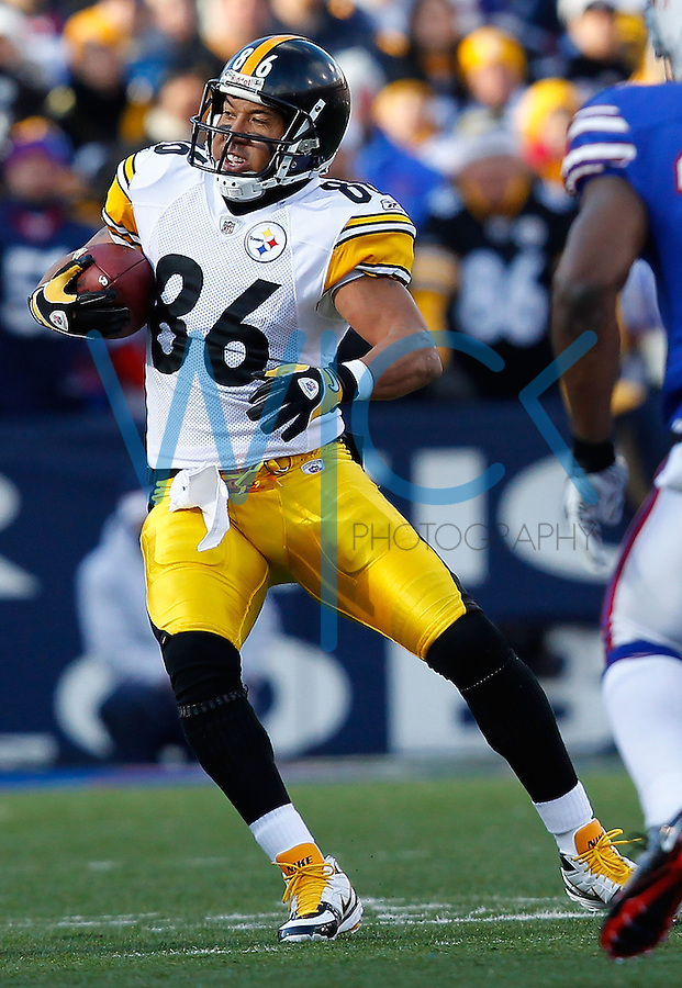 ORCHARD PARK, NY - NOVEMBER 28:  Hines Ward #86 of the Pittsburgh Steelers runs through the Buffalo Bills defense after completing a catch during the game on November 28, 2010 at Ralph Wilson Stadium in Orchard Park, New York.  (Photo by Jared Wickerham/Getty Images)
