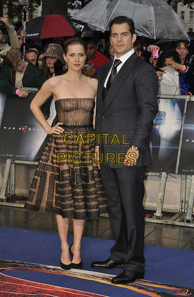 Amy Adams &amp; Henry Cavill<br /> 'Man Of Steel' UK film premiere, Empire cinema, Leicester Square, London, England.<br /> 12th June 2013<br /> full length beige black strapless dress pattern alice band brown lace grey gray suit hand on hip<br /> CAP/DS<br /> &copy;Dudley Smith/Capital Pictures