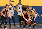 WATERBURY,  CT-021819JS17-  Watertown's Nicole DeFeo (12) and Holy Cross' Hannah Brown (11) battle for a losse ball during their NVL semi-final game Monday at Kennedy High School in Waterbury. <br /> Jim Shannon Republican American