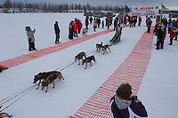 Ashley Guernsey leaves the start line of the 2014 Jr. Iditarod Sled Dog Race from Happy Trails Kennel, Big Lake, Alaska<br /> Saturday February 22, 2014 <br /> <br /> Junior Iditarod Sled Dog Race 2014<br /> PHOTO BY JEFF SCHULTZ/IDITARODPHOTOS.COM  USE ONLY WITH PERMISSION