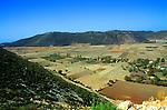 Bezirgan village and farmland in flat land on former lake bed, near Kalkan, Turkey