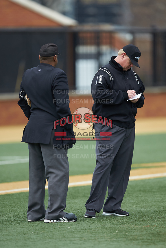 First base umpire Darrell Arnold (right) makes notes as home plate umpire Gregory Street looks on during the ACC baseball game between the Notre Dame Fighting Irish and the Wake Forest Demon Deacons at David F. Couch Ballpark on March 10, 2019 in  Winston-Salem, North Carolina. The Demon Deacons defeated the Fighting Irish 7-4 in game one of a double-header.  (Brian Westerholt/Four Seam Images)