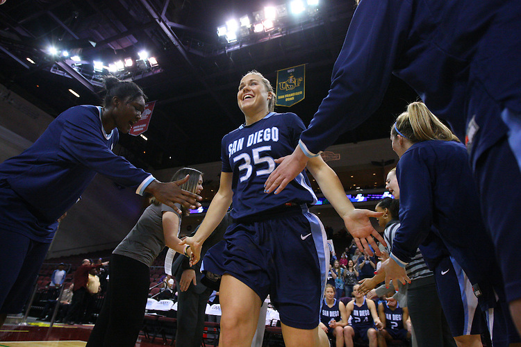 March 6, 2011; Las Vegas, NV, USA; San Diego Toreros forward Emily Hatch (35) high-fives during player introductions during the WCC Basketball Championships semifinal game against the Saint Mary's Gaels at Orleans Arena. The Gaels defeated the Toreros 71-68.