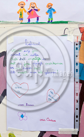 "HEVERLEE - BELGIUM - 14 March 2012 -- Belgian school bus accident in Switzerland. -- At the Sint-Lambertus School in Heverlee (Leuven) pictures from the younger students decorated the wall of the school. -- Text: ""With Love, We support you - because we know - that it is hard - It is painful what happened to you - and we hope - that this will never happen again. (in the harts) Support is - Very Important -- For Hannes from Octavia."" -- PHOTO: Juha ROININEN /  EUP-IMAGES"