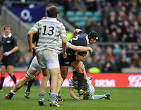Twickenham, GREAT BRITAIN, Oxford wing Gavin TURNER breaking thorough Andrew ABRAHAM'S tackle during the  2012 Varsity Rugby match.  Oxford vs Cambridge, at the RFU Stadium, Twickenham, Surrey. on Thursday  06/12/2012...[Mandatory Credit; Peter Spurrier/Intersport-images]