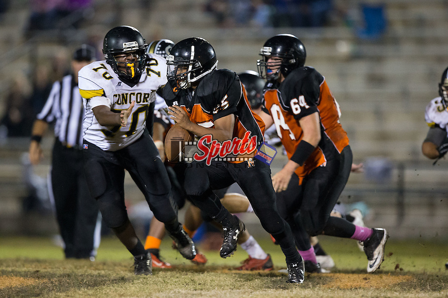 Vincent Barnett (25) of the Northwest Cabarrus Trojans runs with the football during second half action against the Concord Spiders at Trojan Stadium October 29, 2015, in Concord, North Carolina.  The Spiders defeated the Trojans 30-26.  (Brian Westerholt/Sports On Film)