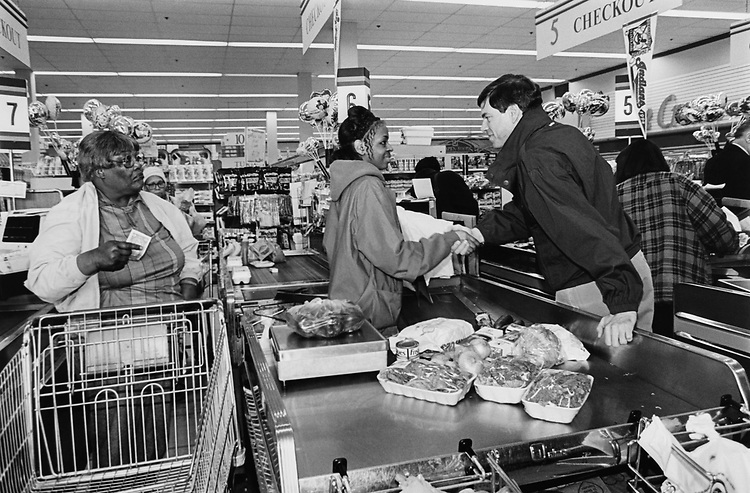 Democratic Senate Candidate Joel Hyatt hits grocery stores to campaign. Here at Heinens, he greets the checkout clerk on April 23, 1994. (Photo by CQ Roll Call via Getty Images)