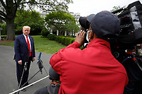 United States President Donald J. Trump speaks to the media on the South Lawn of the White House in Washington, DC before his departure to Detroit, Michigan on May 21, 2020. Trump is going to participate in a listening session with African-American leaders and tour Ford Rawsonville Components Plant in Ypsilanti, Michigan. <br /> Credit: Yuri Gripas / Pool via CNP /MediaPunch