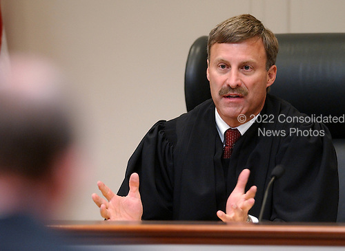Prince William County (Virginia) Judge LeRoy Millett Jr., gestures as he speaks to attorneys during the trial of sniper suspect John Allen Muhammad, at the Virginia Beach Circuit Court  in Virginia Beach, Virginia on October 24, 2003.  <br /> Credit: Davis Turner - Pool via CNP