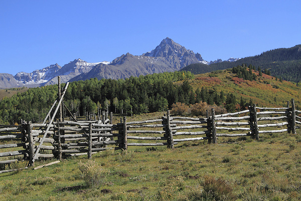 Mount Sneffels (14,150 ft) with fence and corral, Southwest Colorado. John offers autumn photo tours throughout Colorado.