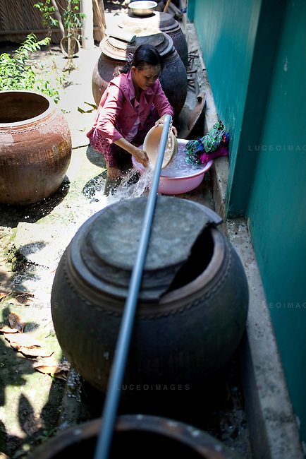 Doan Thi Ut, 43, washes her laundry in clean water provided by the Tien Phat enterprise in the Luong Hoa Lac commune.