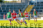 Maro O'Connor Daingean Uí Chúis tracks Ciaran Kennedy Mid Kerry  during the County Minor championship final in Fitzgerald Stadium on Sunday