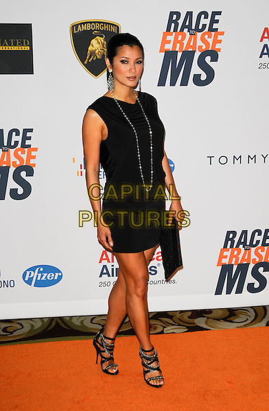 KELLY HU .Arriving at The 17th Annual Race to Erase MS at the Hyatt Regency Century Plaza Hotel in Century City, California, USA, May 7th, 2010..full length black sleeveless dress necklace studded studs sandals strappy .CAP/ROT.©Lee Roth/Capital Pictures