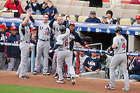 22 March 2009: #6 Brian Roberts of USA is congratulated by teammates after hitting a solo homerun in the first inning during the 2009 World Baseball Classic semifinal game at Dodger Stadium in Los Angeles, California, USA. Japan wins 9-4 over Team USA.