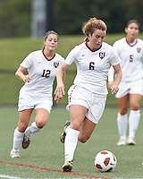 Harvard University midfielder Haley Washburn (6) brings the ball forward. In overtime, Harvard University defeated Yale University,1-0, at Soldiers Field Soccer Stadium, on September 29, 2012.