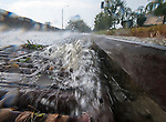During a heavy rainstorm a storm drain on Moreland Parkway in Annapolis is deluged with a rushing stream of water.