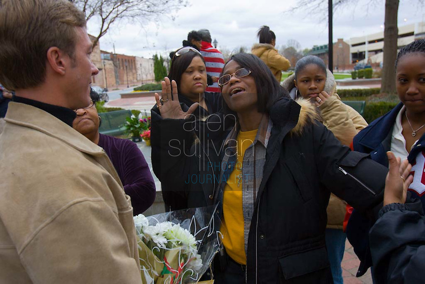 Venisha Brown (center), daughter of singer James Brown and one-time backup singer Yvonne Fair, with Augusta, Ga. mayor Deke Copenhaver (left) by a statue of the hometown singer on Broad Street. James Brown died in Atlanta on Monday, Dec. 25. Also pictured are James Brown's daughter-in-law Diane D. Rowes (from left), her daughter Carmen Schultz, and James Brown's great-granddaughters Chelsea Dean and Saquoia Walton.