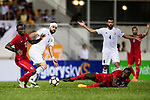 Ibrahim Zawahreh of Jordan (C) fights for the ball with Alexander Oluwatayo Akande of Hong Kong (L) during the International Friendly match between Hong Kong and Jordan at Mongkok Stadium on June 7, 2017 in Hong Kong, China. Photo by Marcio Rodrigo Machado / Power Sport Images